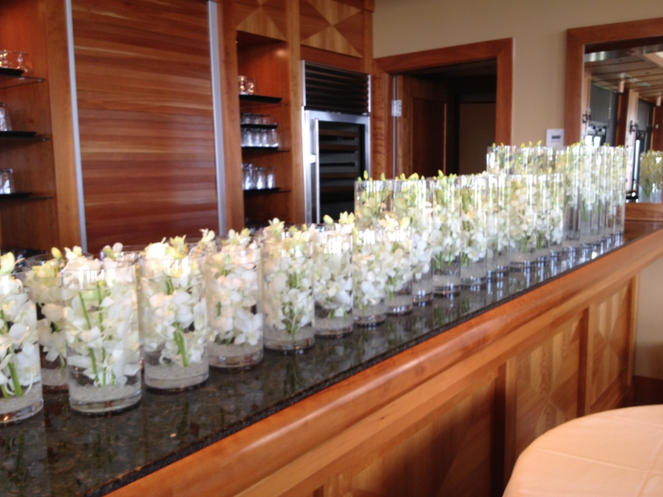 All the centerpiece vases lined up waiting to be filled!