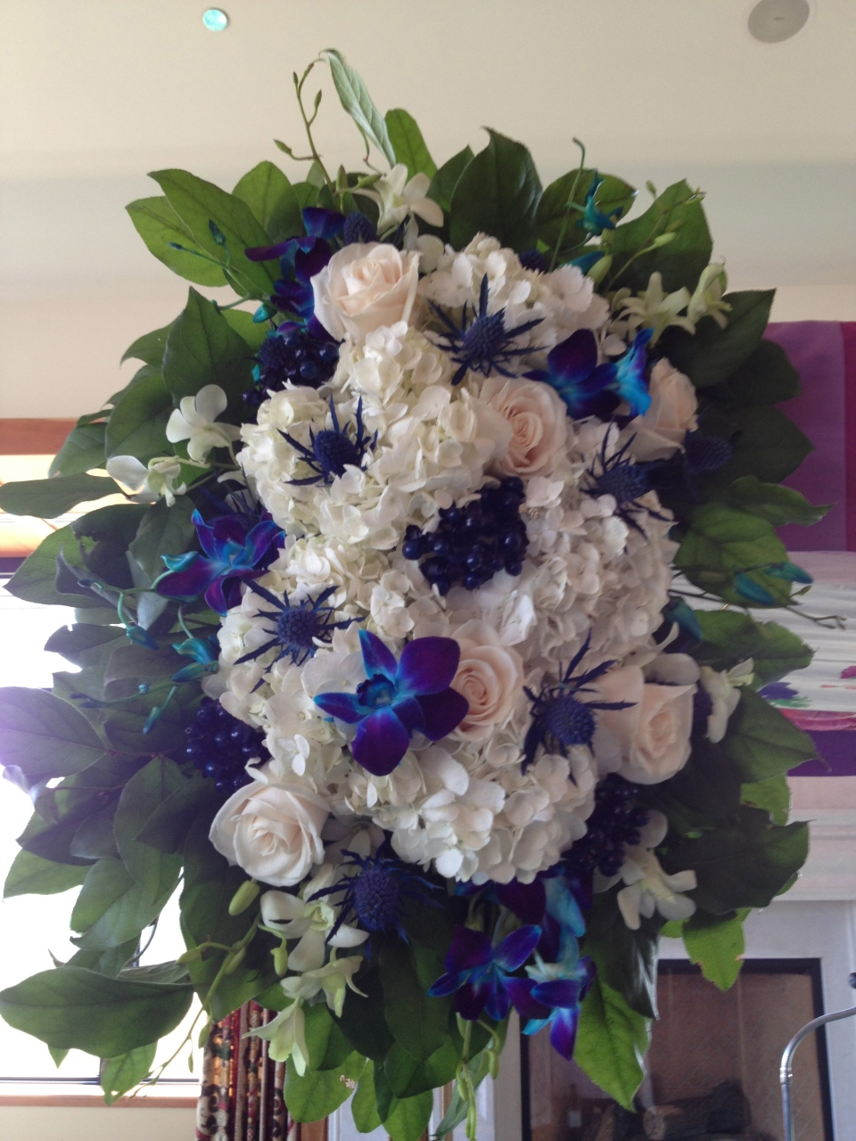 Chuppah decor included hydrangea, scottish thistle, tinted berries, roses and dendrobium orchids
