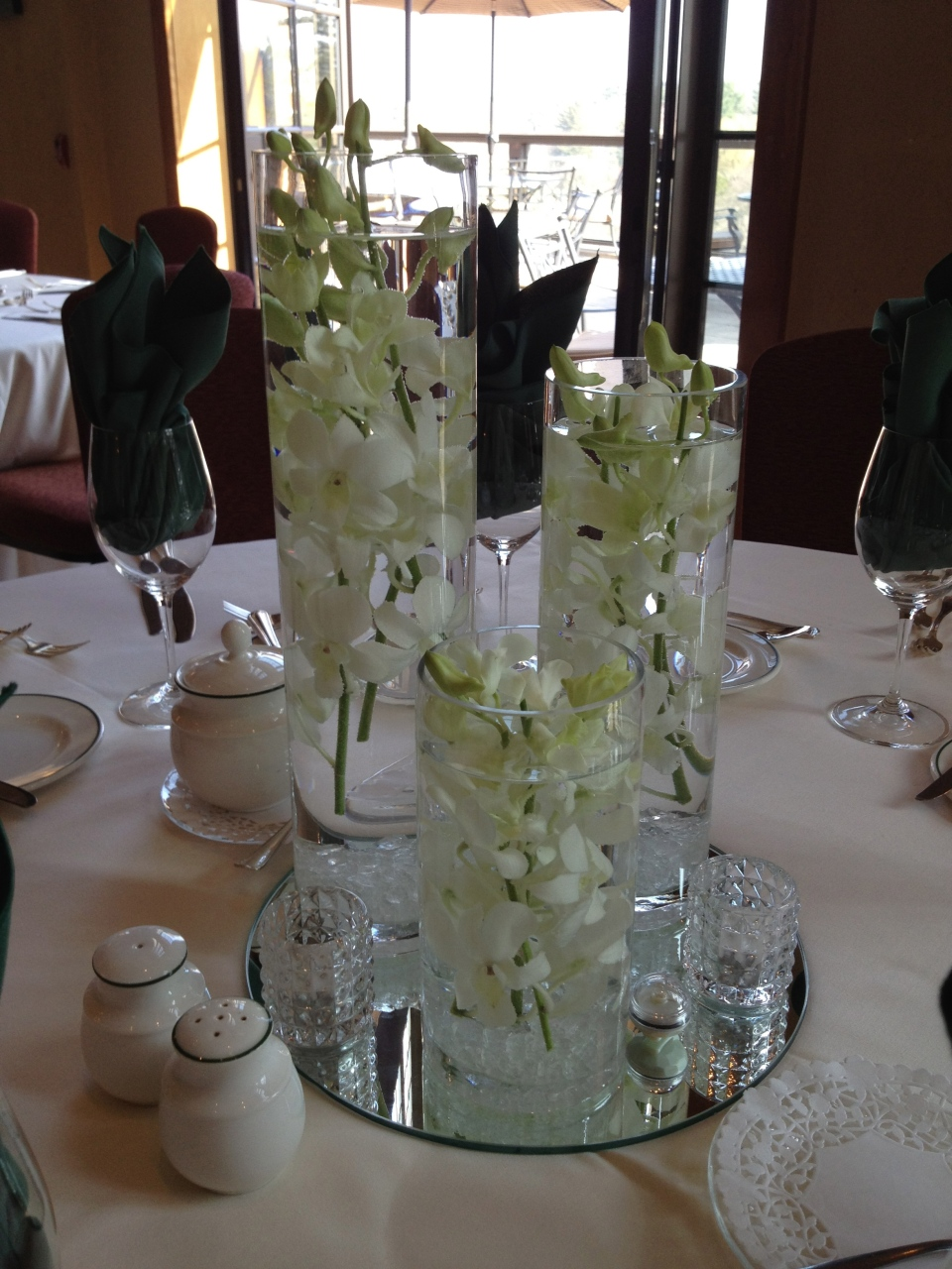Simple and elegant three piece submerged orchid centerpiece
