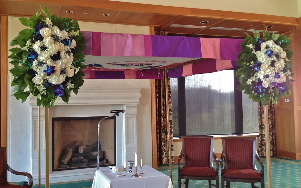 Ivory, blue and green chuppah flowers