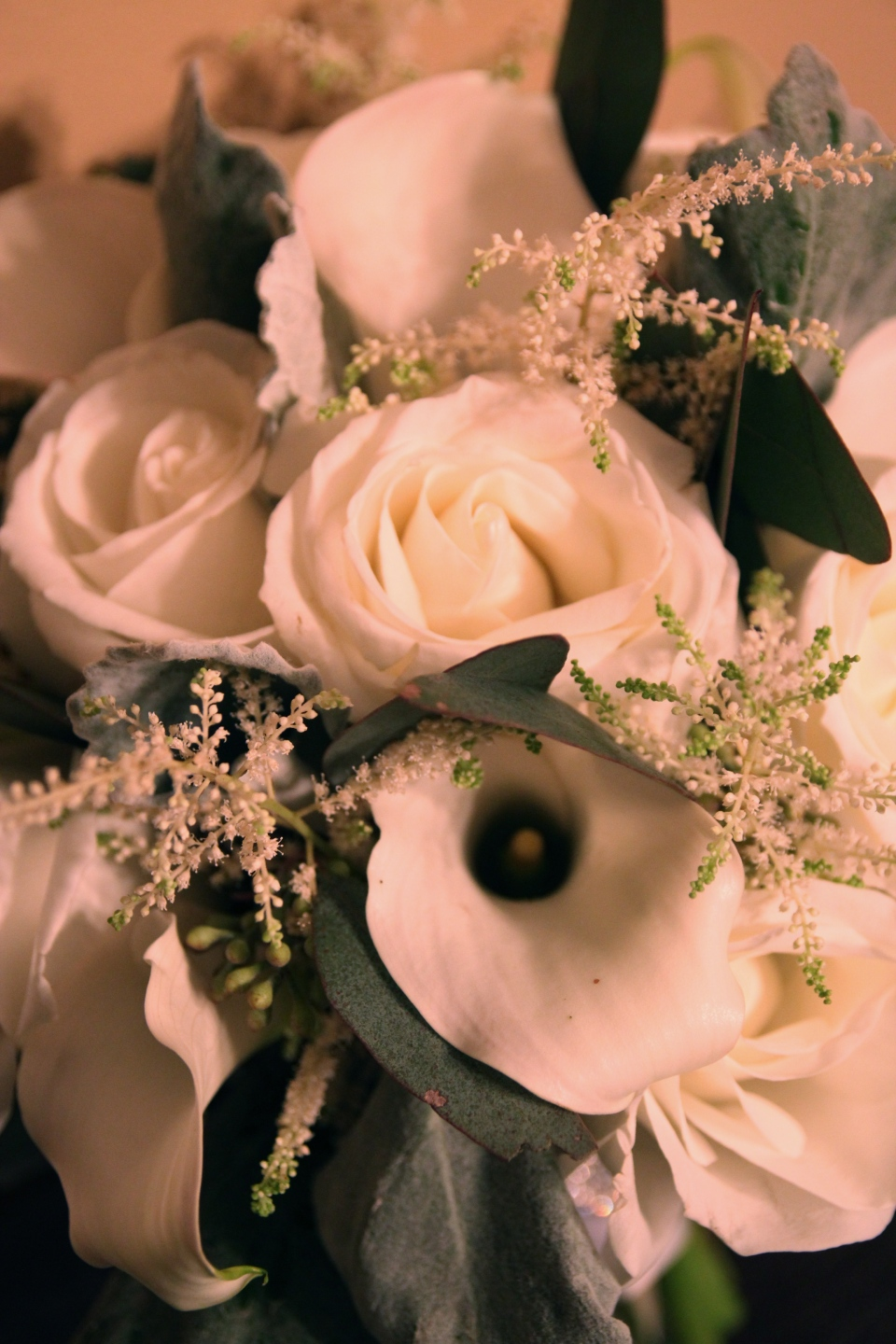 Bouquet detail of roses, astilbe and calla lilies