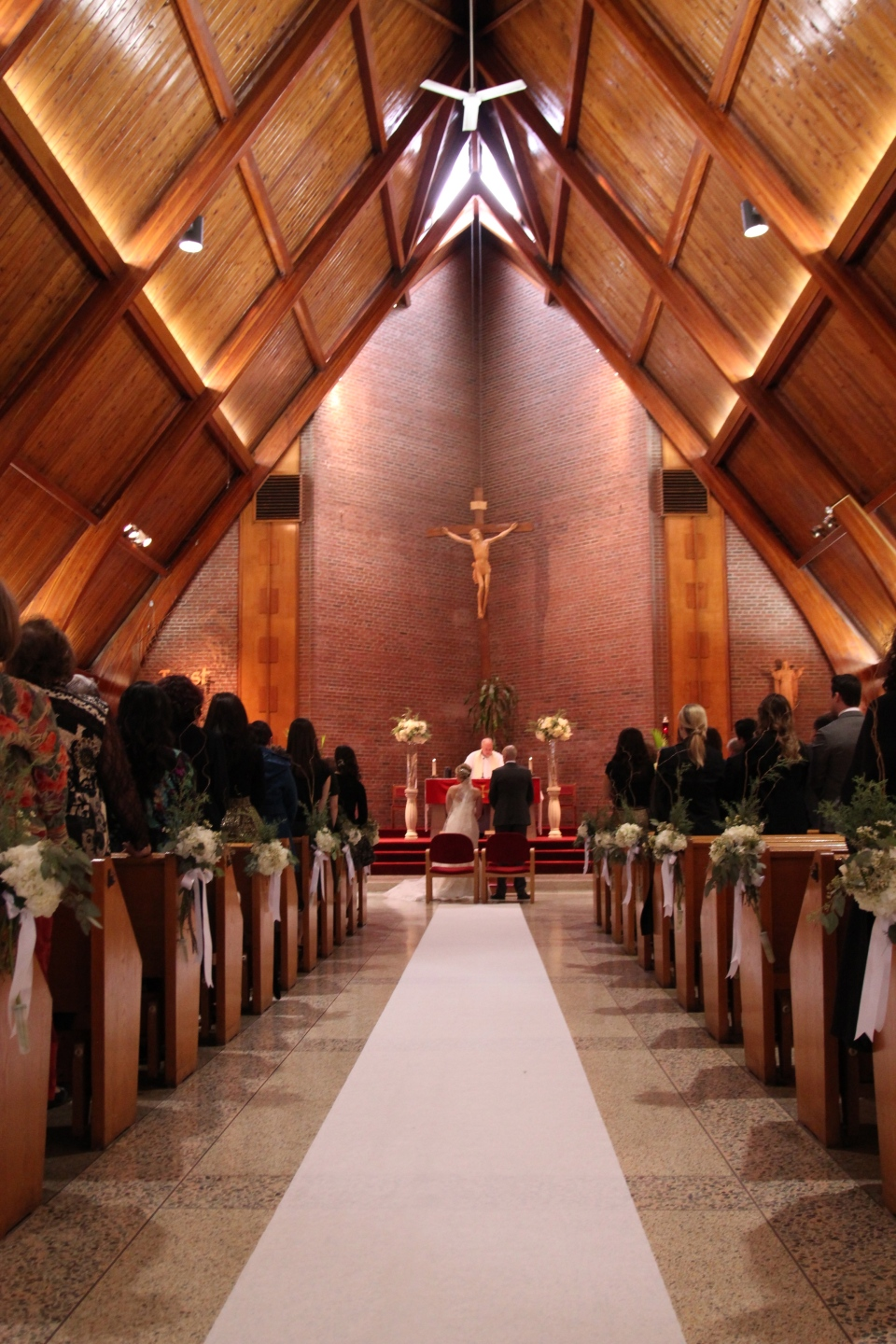 Winter wedding church ceremony flowers