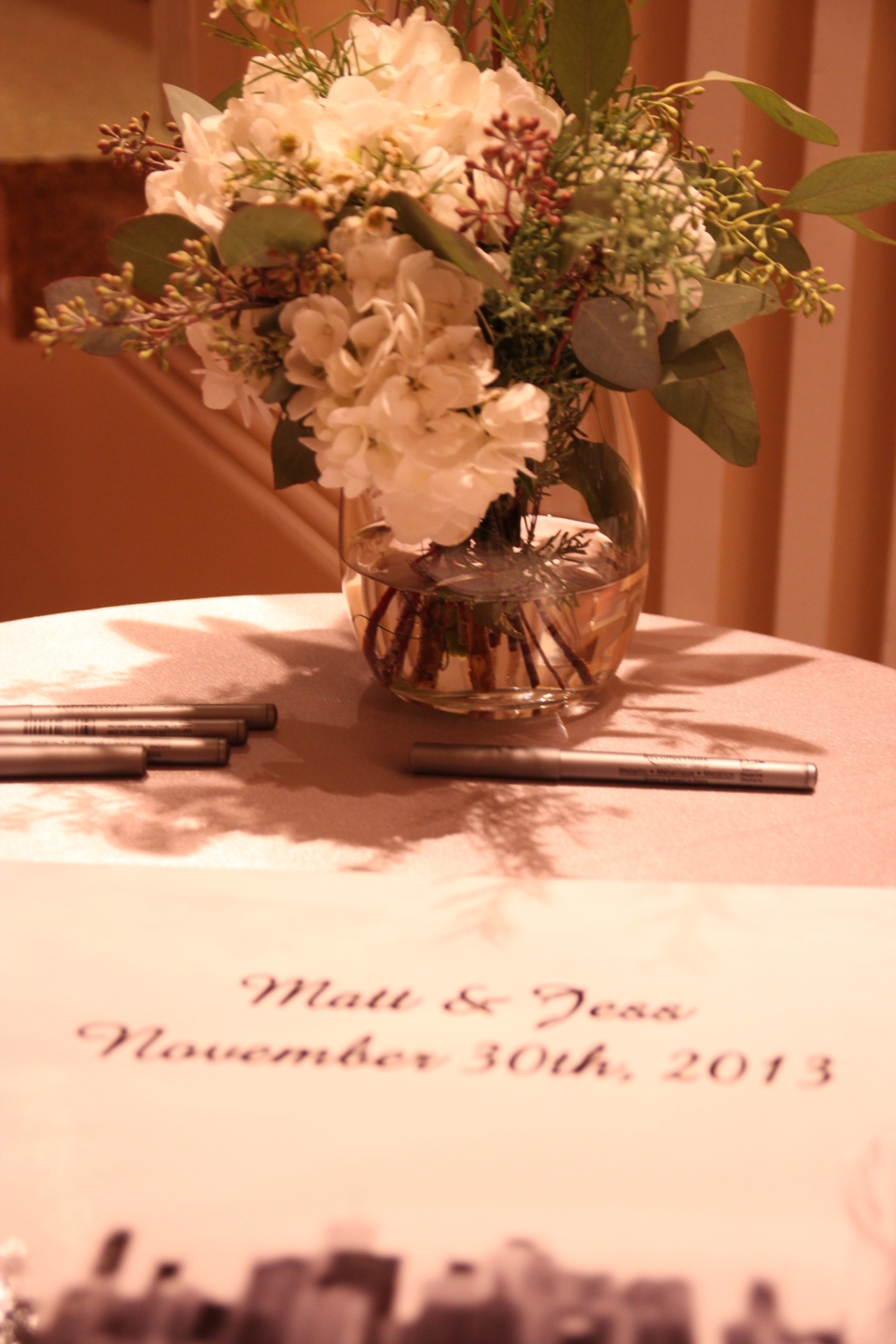 Aisle flowers make a reappearance at the reception!