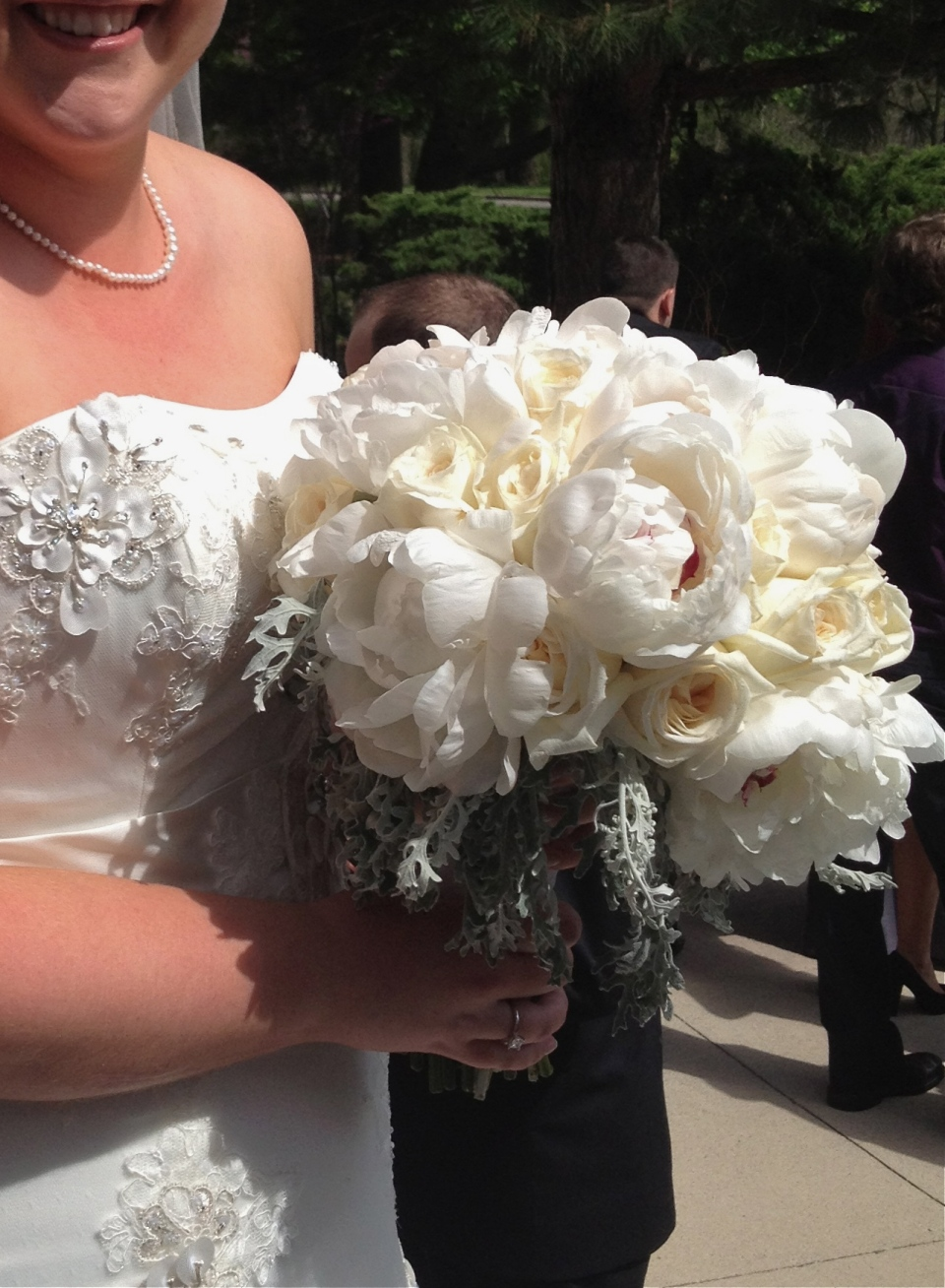 Oversized white bouquet of peonies, garden roses and dusty miller