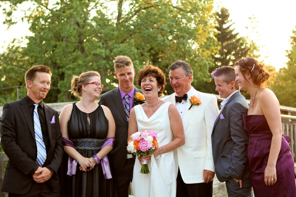 A great shot of the happy couple with their family