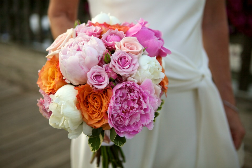 Pink and coral bridal bouquet of peonies, cabbage roses & spray roses.