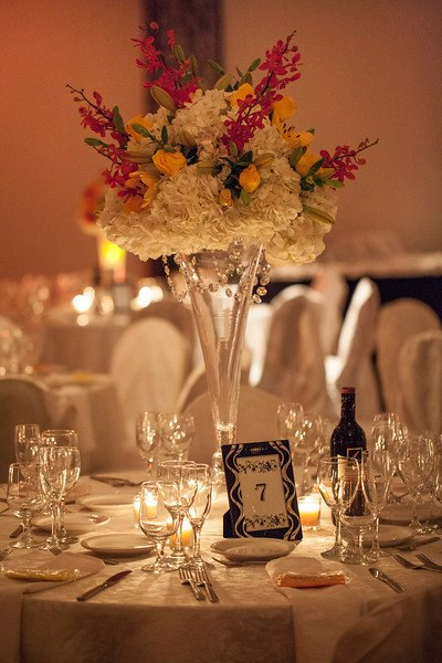 Tropical inspired tall centerpieces with candlelight