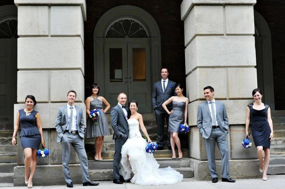 Royal blue bouquets pop against charcoal dresses