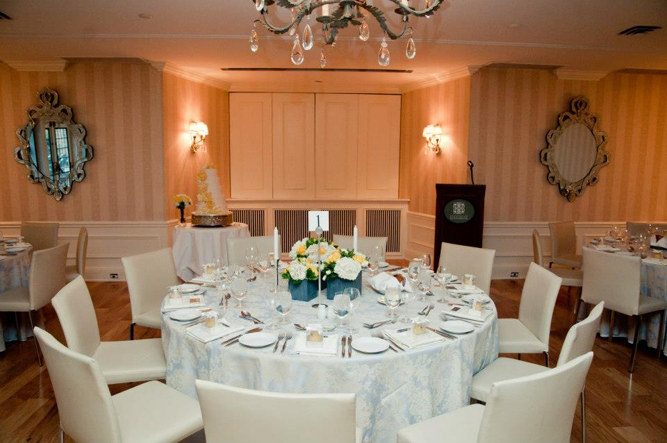 The elegant reception space at The Estates of Sunnybrook with lovely low centerpieces.