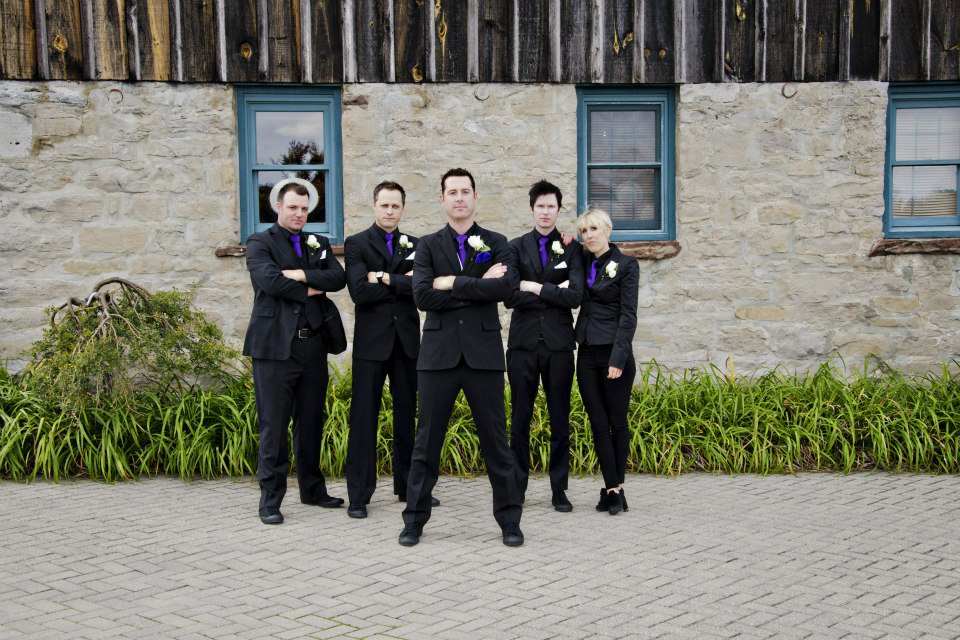 The boys looking sharp with purple ties and white rose boutonnieres