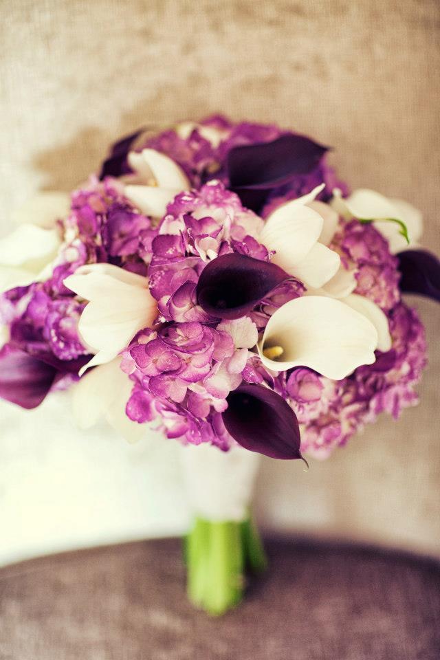 Purple bridal bouquet of hydrangea, calla lilies and cymbidium orchids