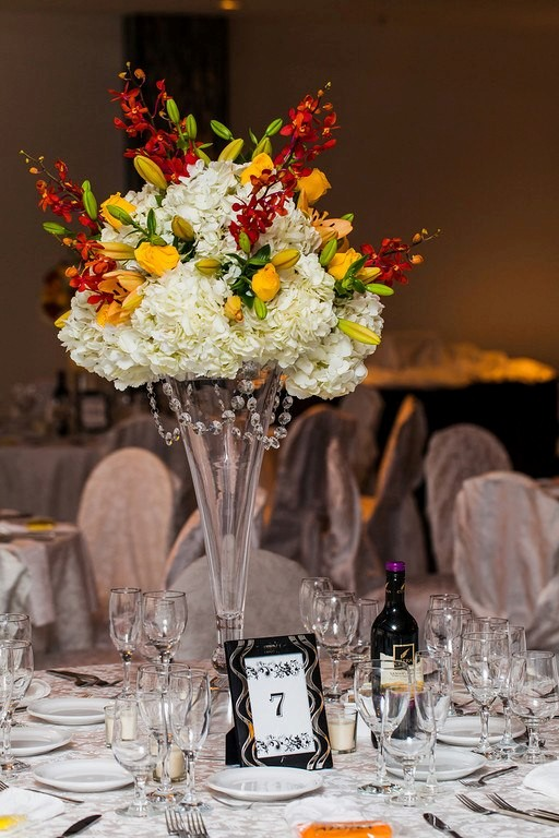 Tropical inspired centerpieces of hydrangea, lilies, roses and mokara orchids.