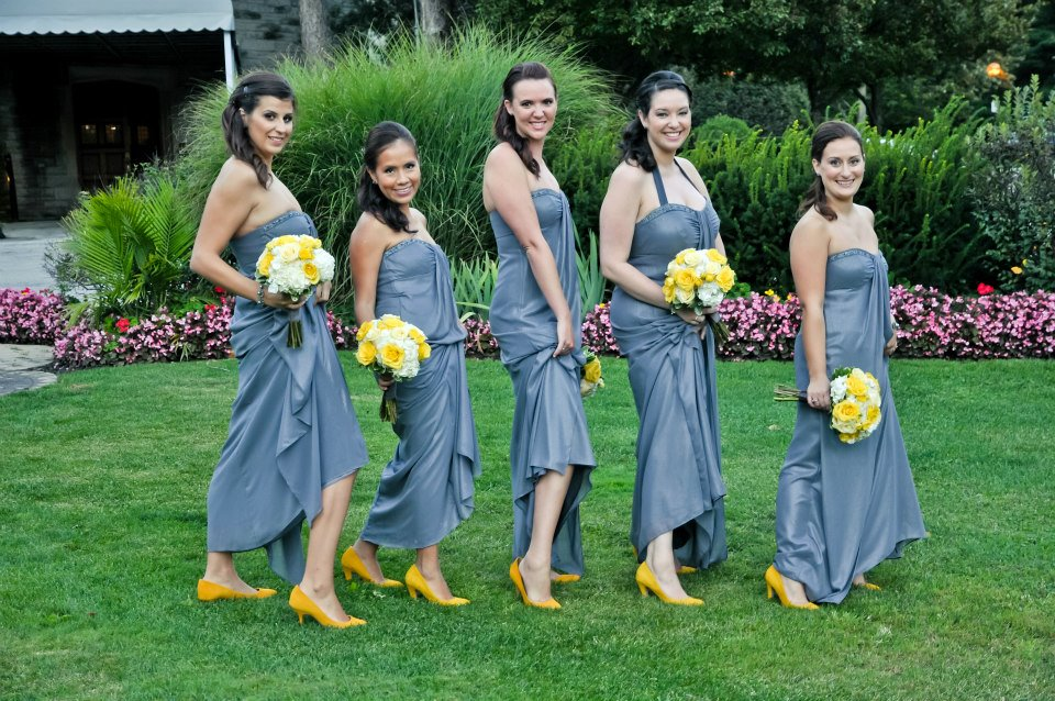 Yellow bouquets pop against grey dresses