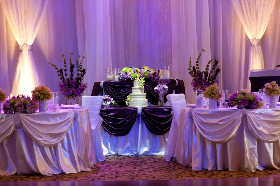 Purple and green accents at the head table