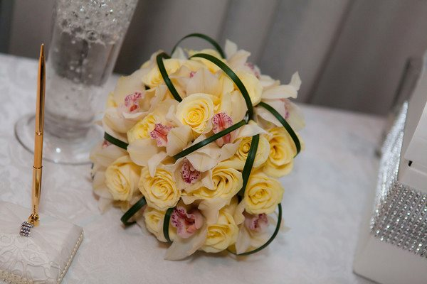 Ivory cymbidiums and butter cream roses for the reception bouquet.