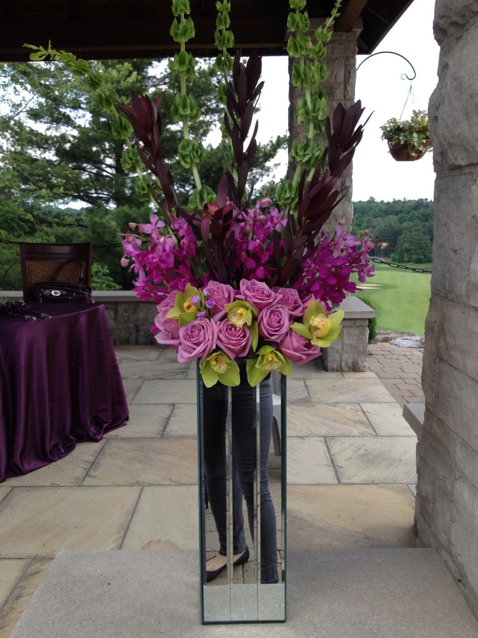 Altar arrangements of roses, orchids & leucadendron