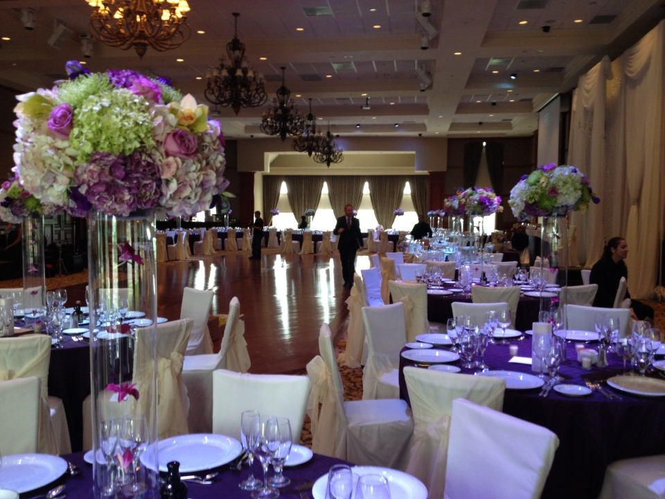 Purple and green tall centerpieces at Copper Creek