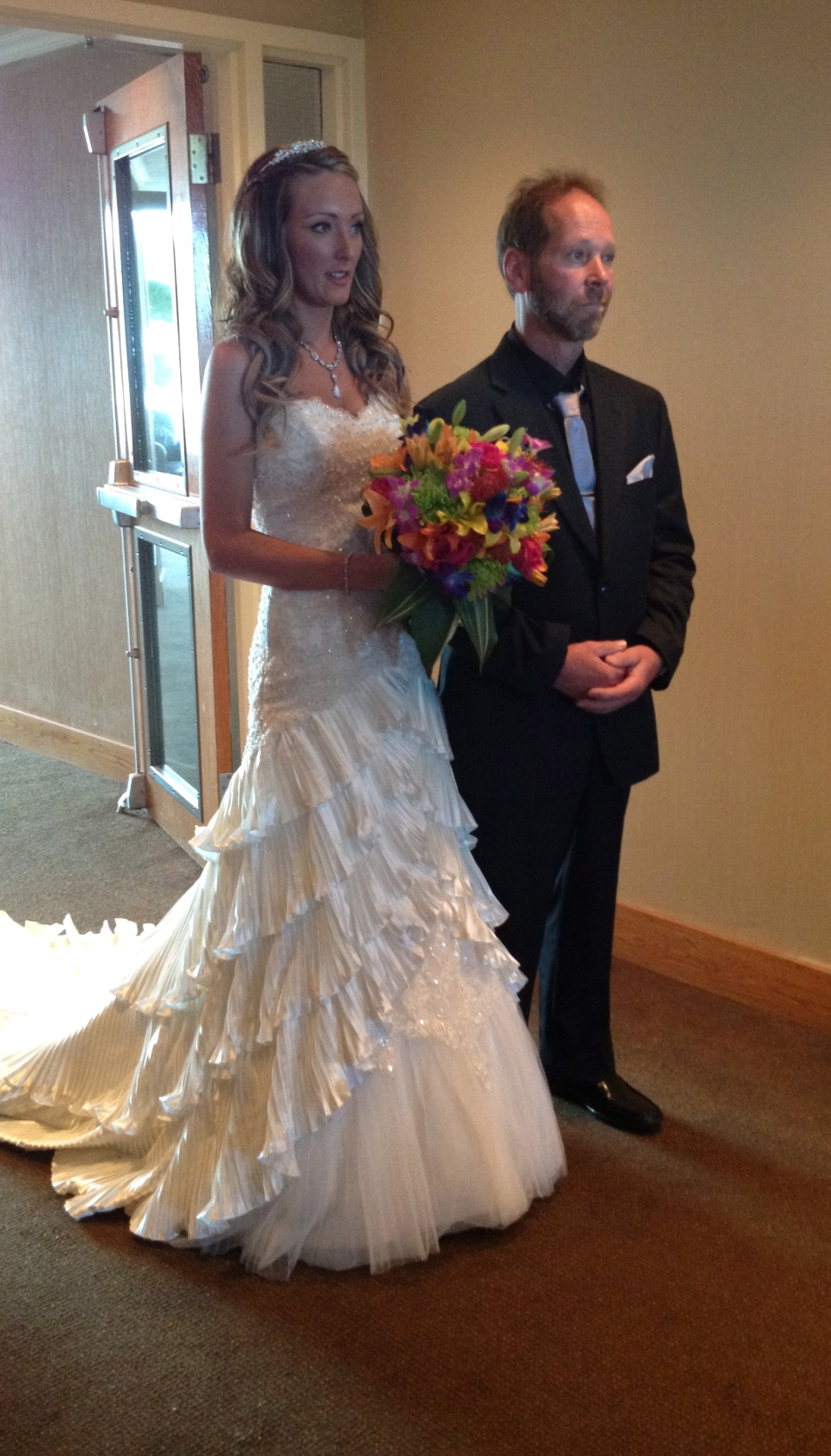 The beautiful bride with her colourful bouquet