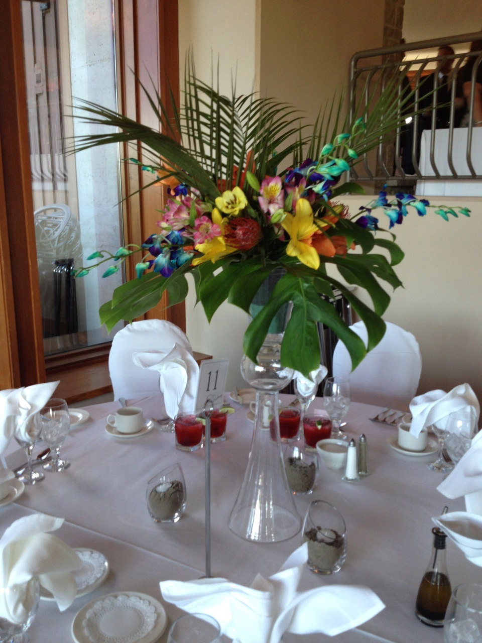 Tropical tall centerpieces of tropical leaves and colourful blooms