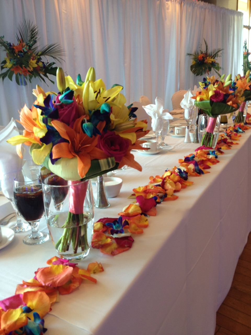Tropical bouquets were used at the head table as additional decor