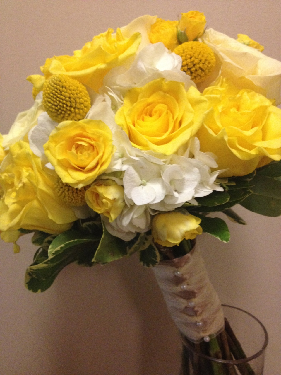 Yellow bridal bouquet of hydrangea, roses, spray roses & craspedia