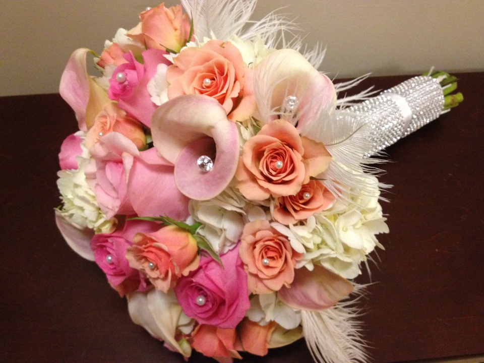 The Bridal Bouquet of Hydrangea, Roses, Spray Roses & Calla Lilies with Feathers, Crystals & Pearls.