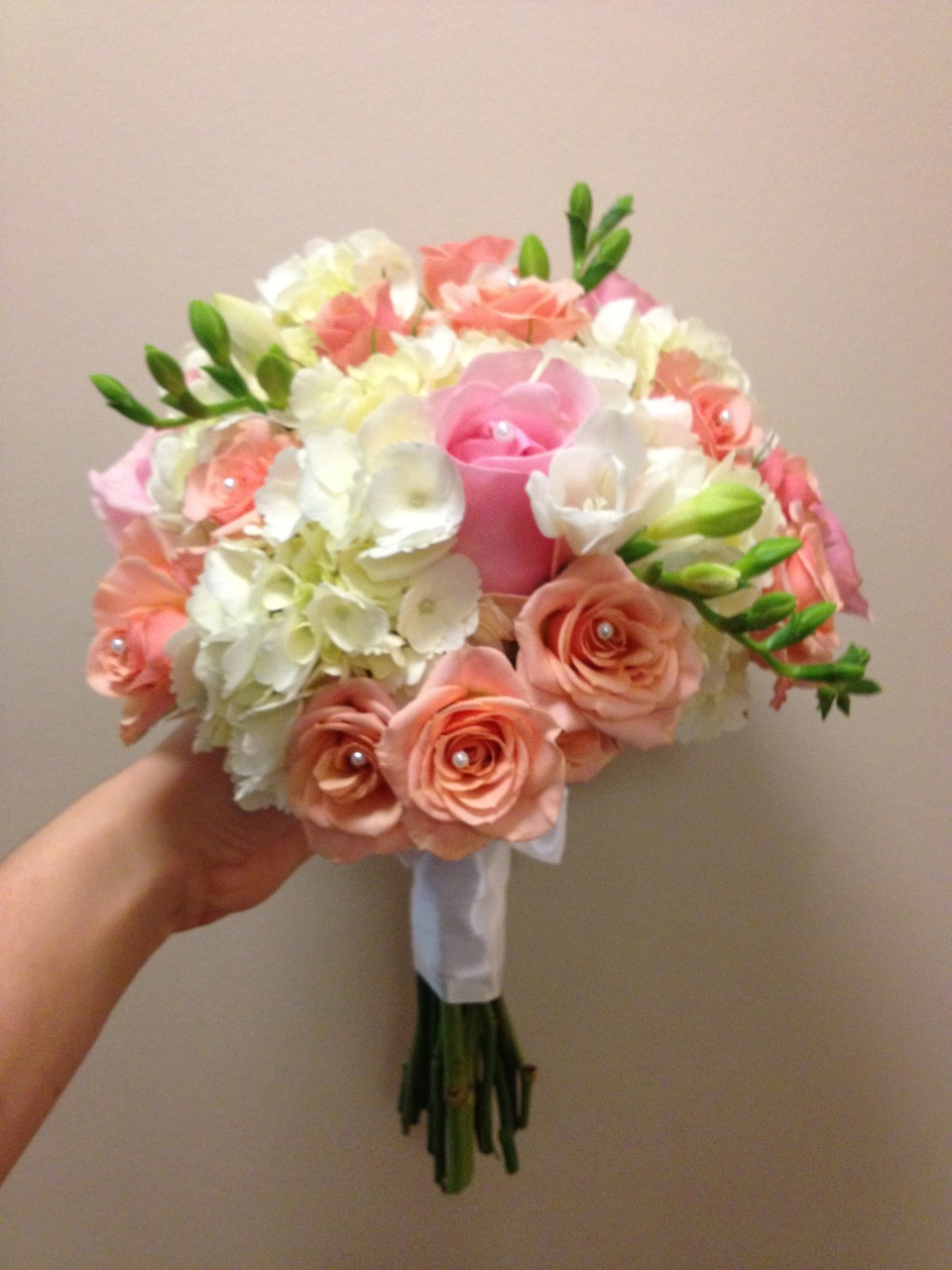 Bridesmaids Bouquets of Hydrangea, Roses, Spray Roses & Freesia with Pearl detailing.