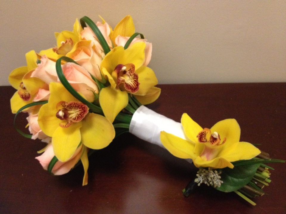 Yellow cymbidium orchid and peach rose bridal bouquet and boutonniere
