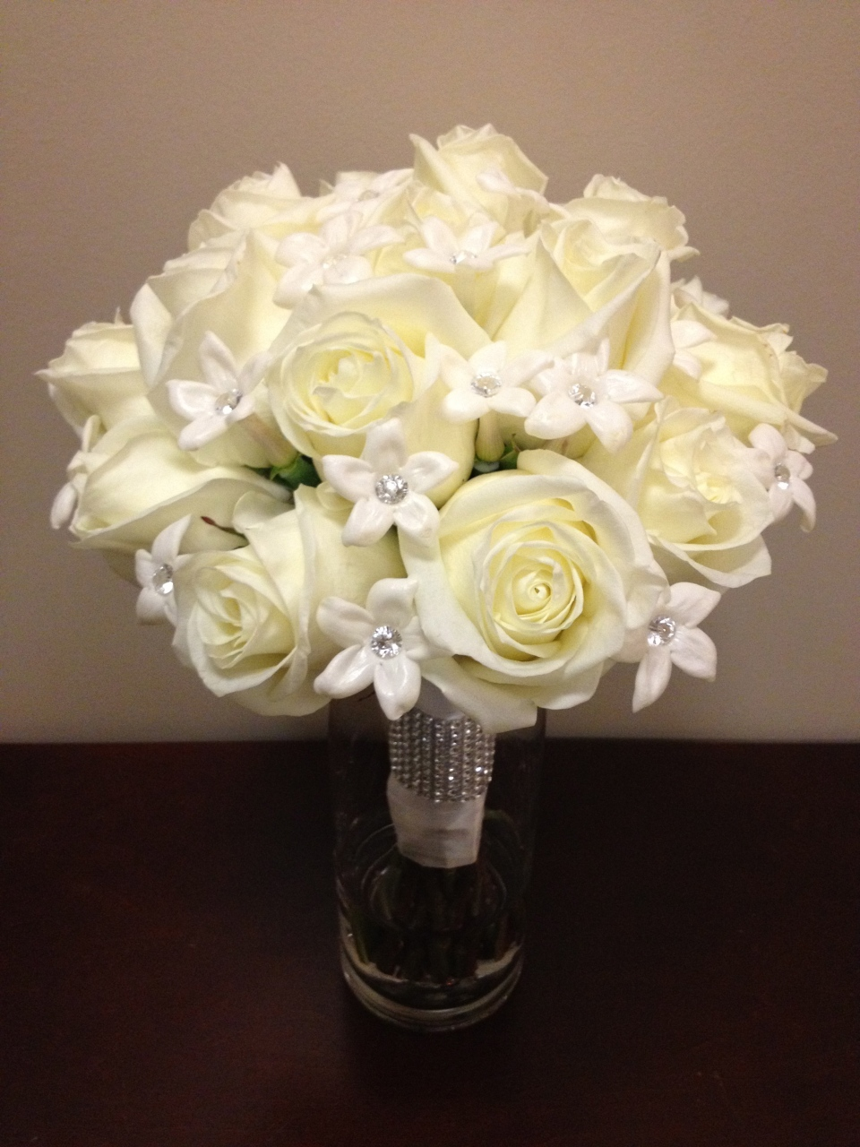 Bridal bouquet of white roses and stephanotis blooms