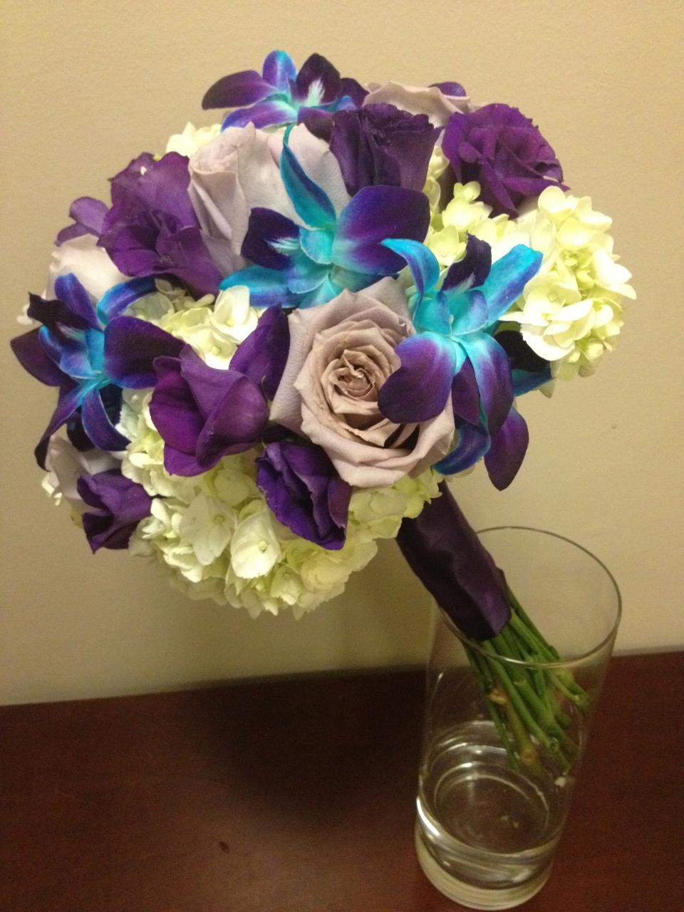 Bridesmaids bouquet of hydrangea, roses, lisianthis & dendrobium orchids.