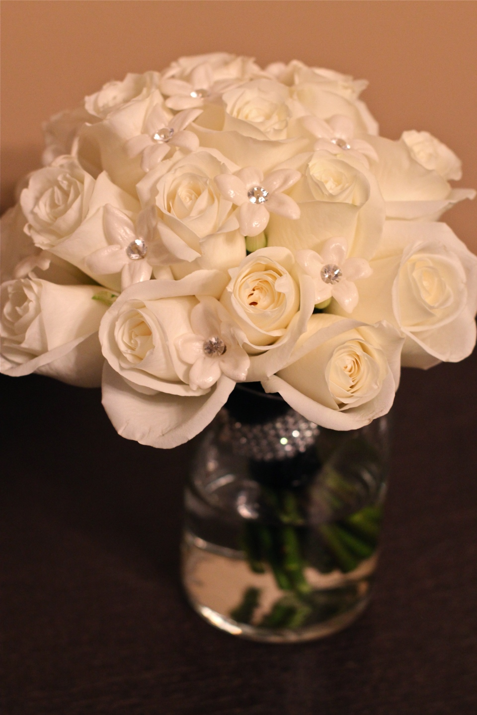 Bridesmaids bouquets of white roses & stephanotis.