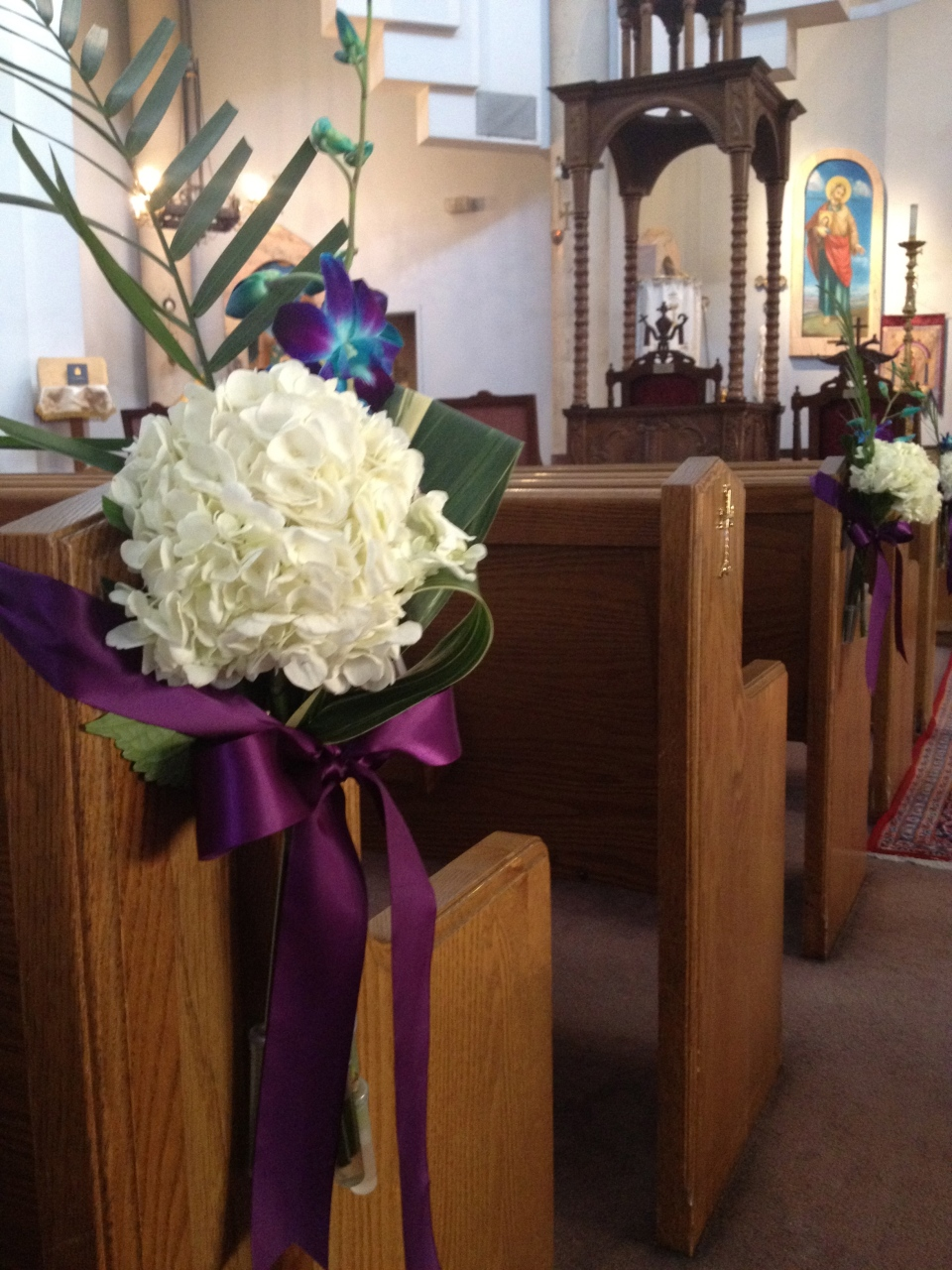 Hydrangea, orchid and fern pew markers