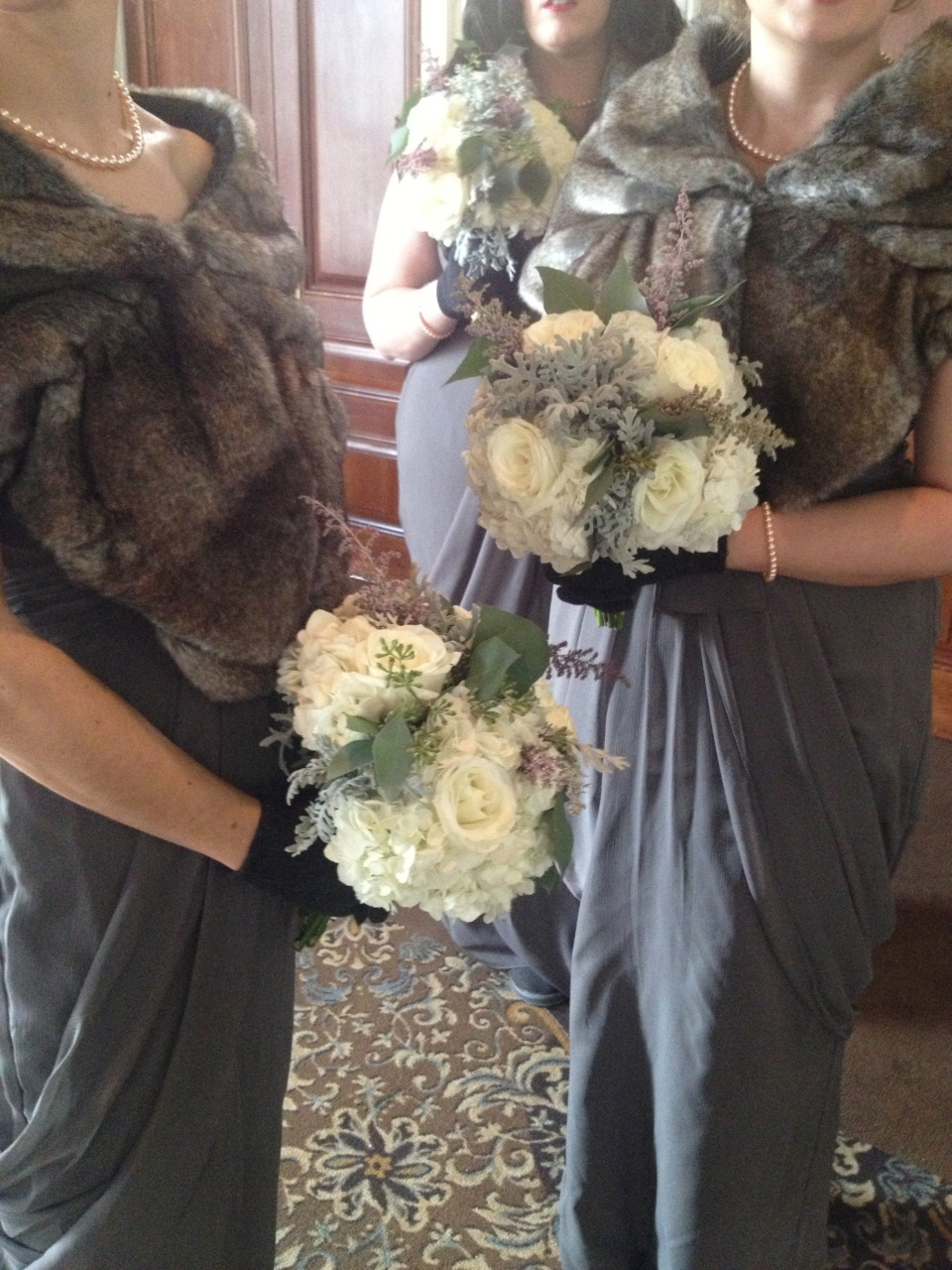 Winter bridesmaids bouquets of hydrangea, roses, dusty miller and seeded eucalyptus