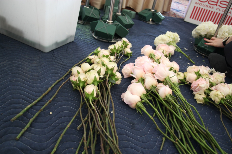 Champagne and blush roses prepped for the centerpieces