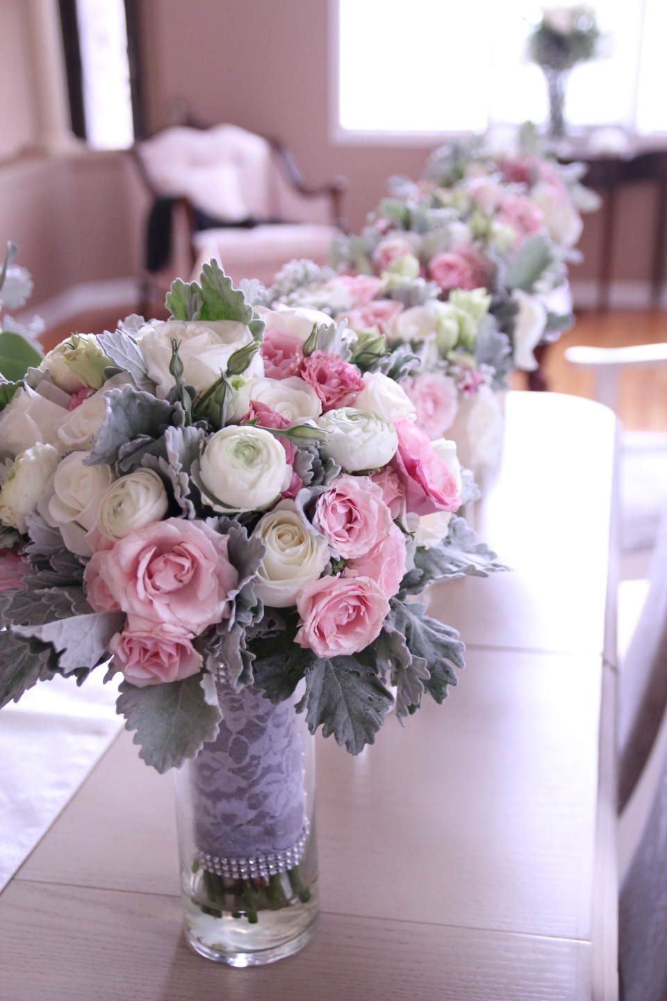 Romantic bouquet of roses, spray roses, lisianthus, ranunculus and dusty miller
