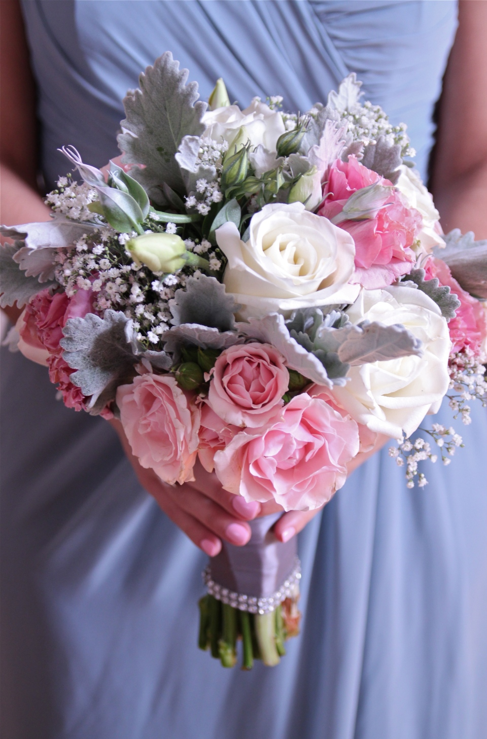 Vintage bouquet of roses, spray roses, lisianthus, baby's breath and dusty miller