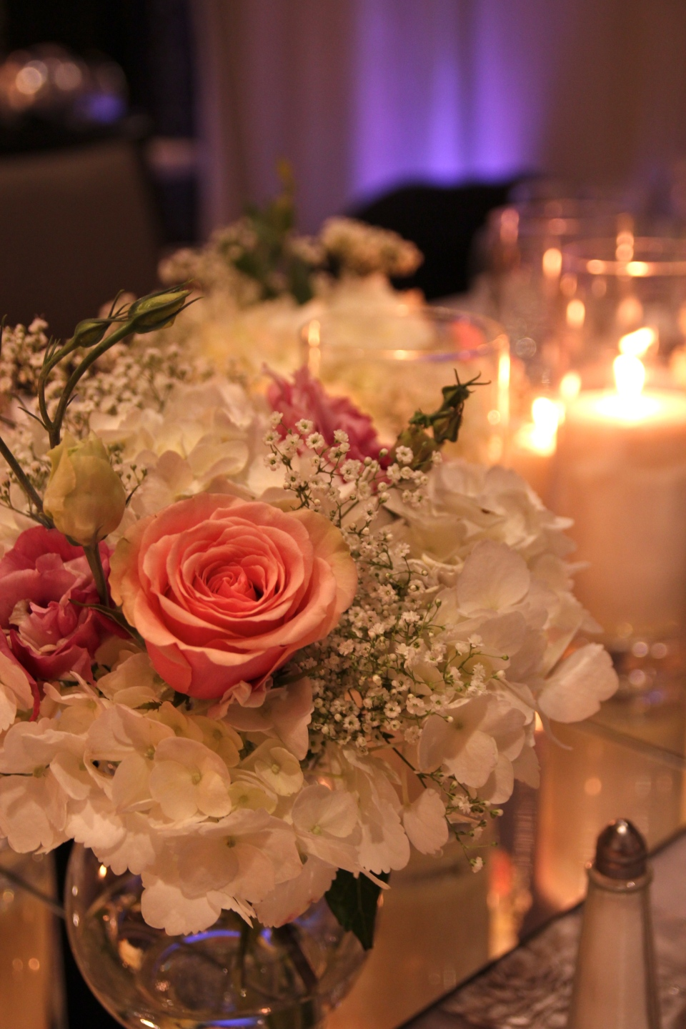 Head table flowers of hydrangea, roses, lisianthus and baby's breath