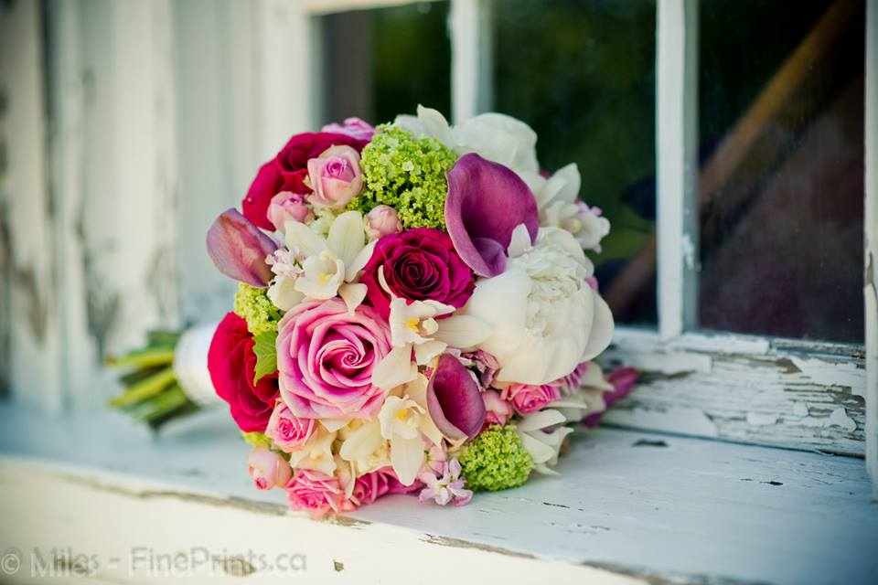 Gorgeous pinks and greens with ivory touches make this bouquet perfection! Photo credit: Fine Prints Wedding