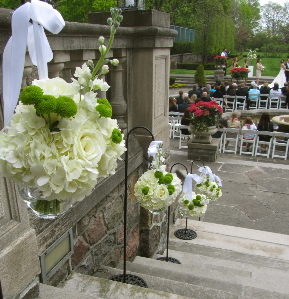 Green and White Flowers down stone staircase