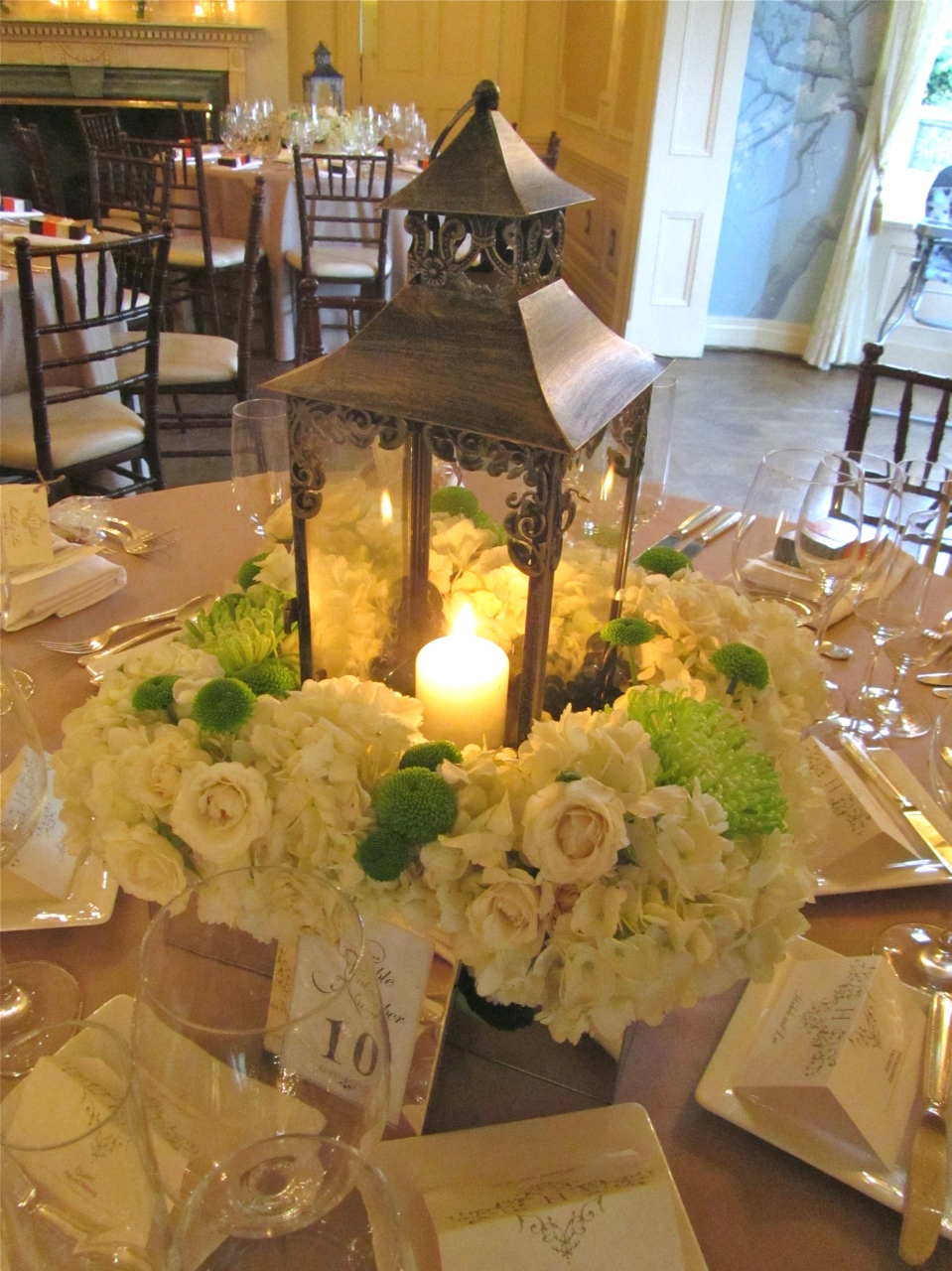 Lantern centerpiece with floral base.