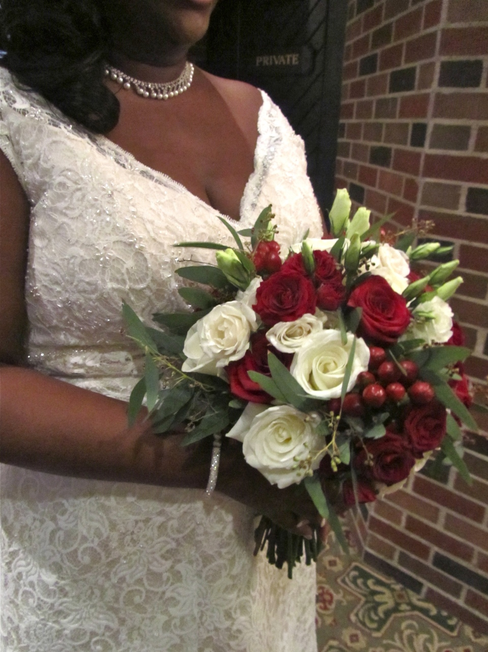 Cranberry, white and greenery bouquet
