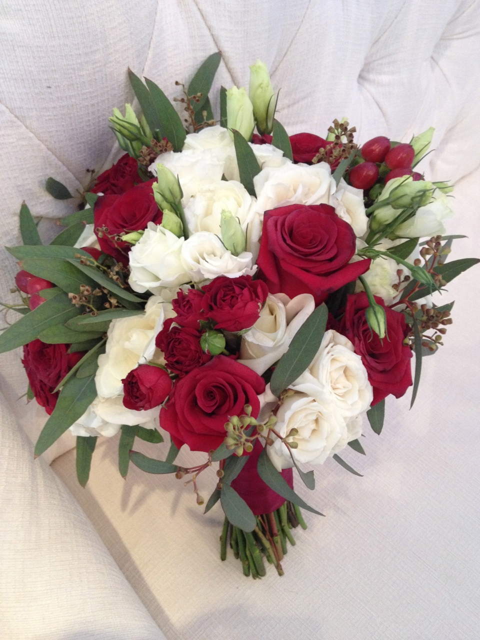 Garden style bouquet in cranberry and white.