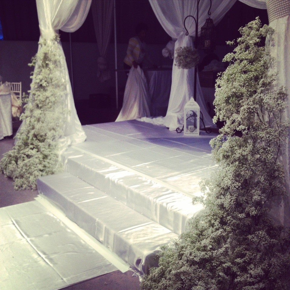 Trailing baby's breath detailing on the altar canopy.