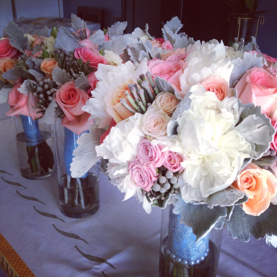 Coral, peach, ivory and grey bouquets