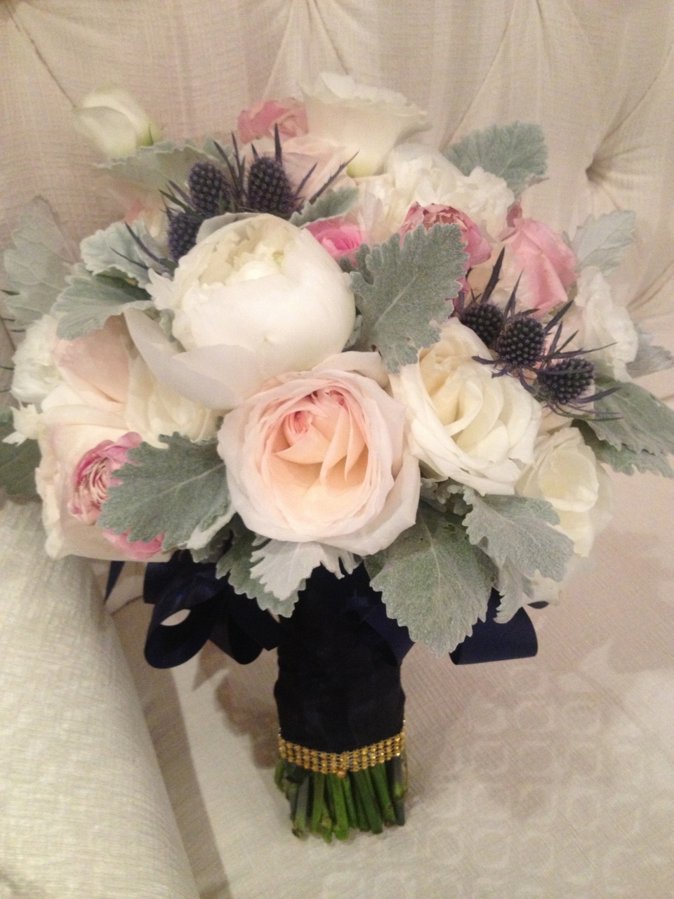 Bouquet peonies, garden roses, roses, spray roses, thistle and dusty miller.