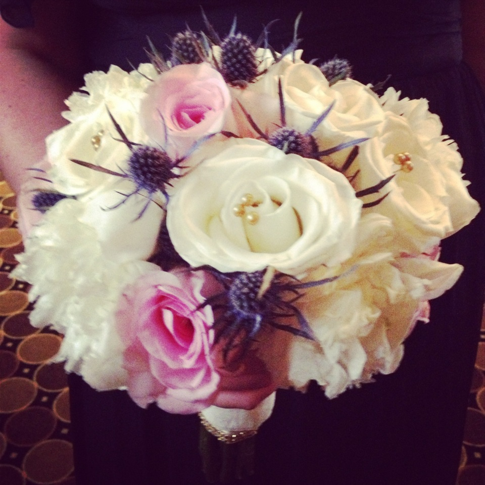 Bridesmaids bouquet of peonies, roses and thistle