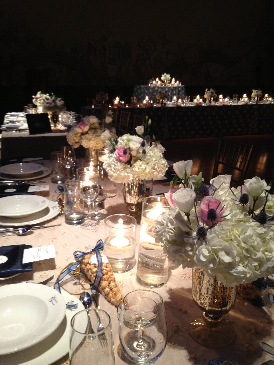 Gallery tables with blush, ivory, navy and gold flowers