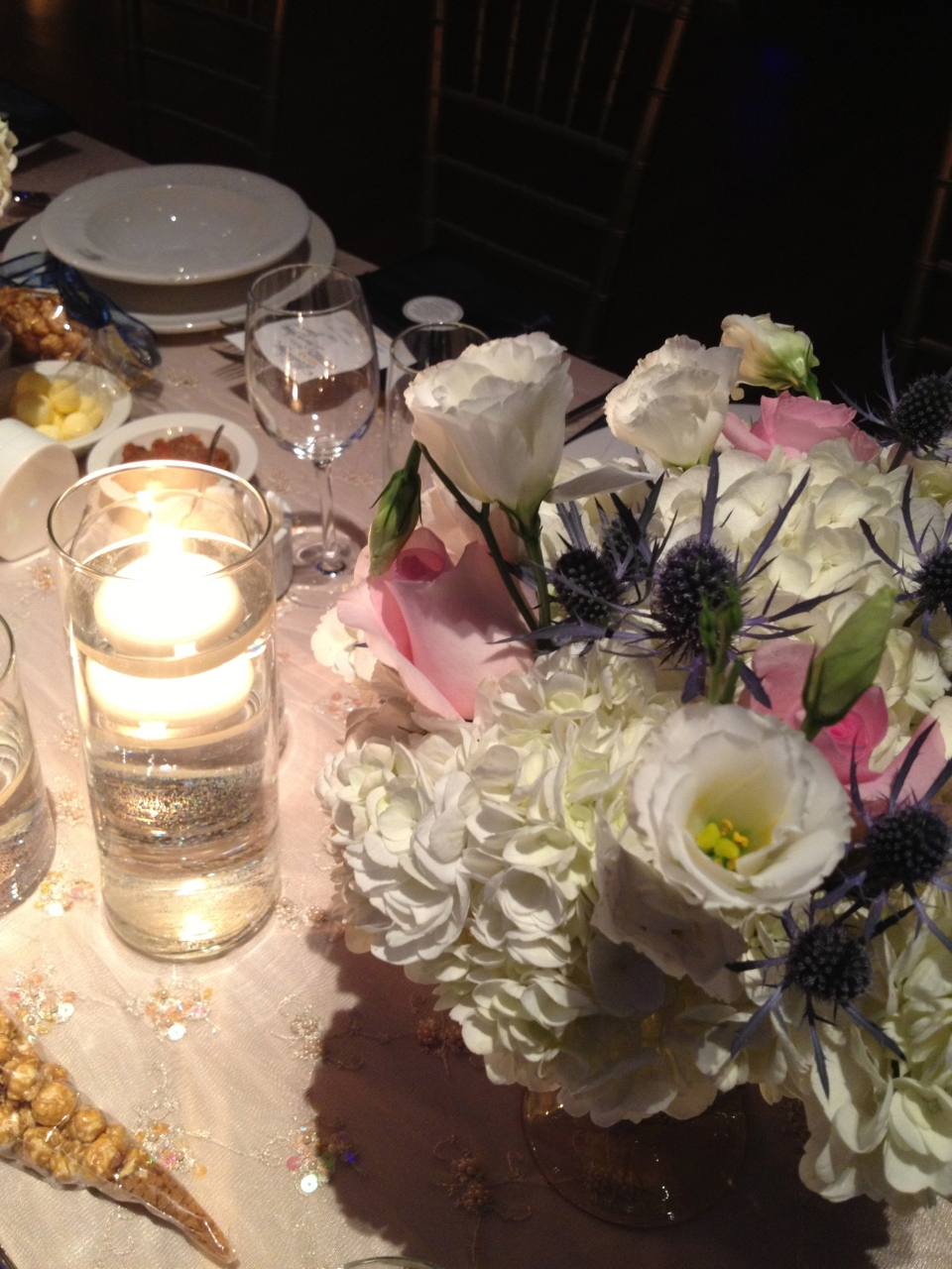 Hydrangea, roses, lisianthus and thistle arrangement.