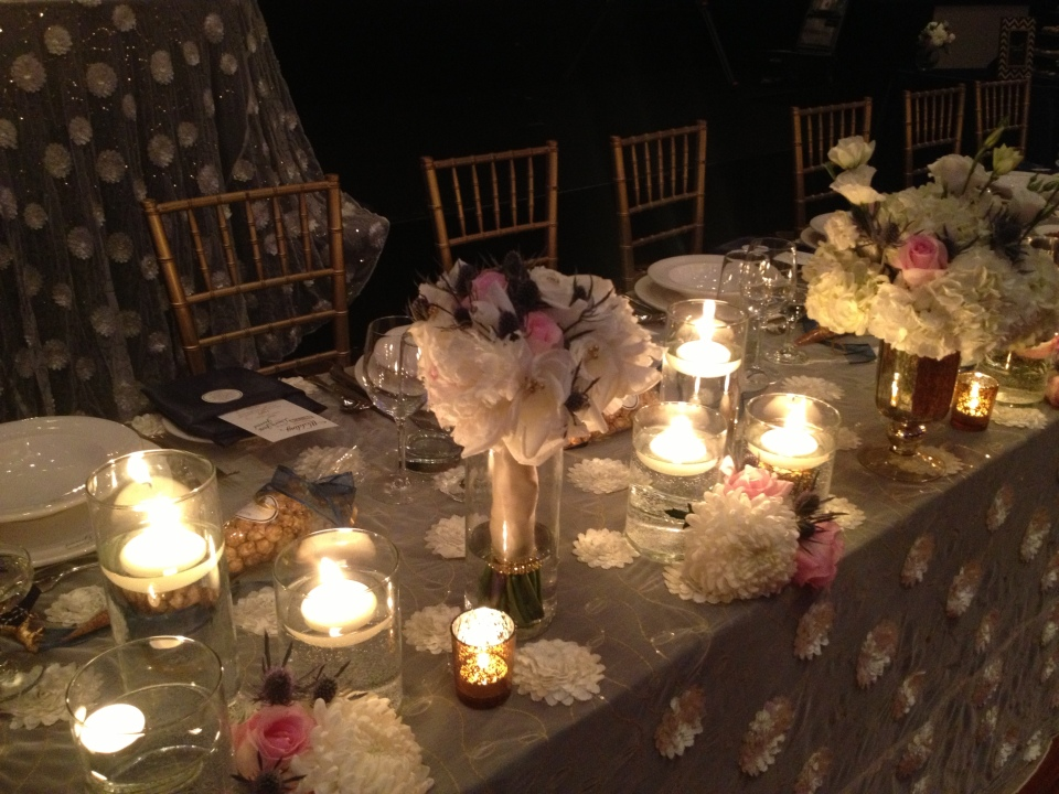 Head table with bouquets and candles