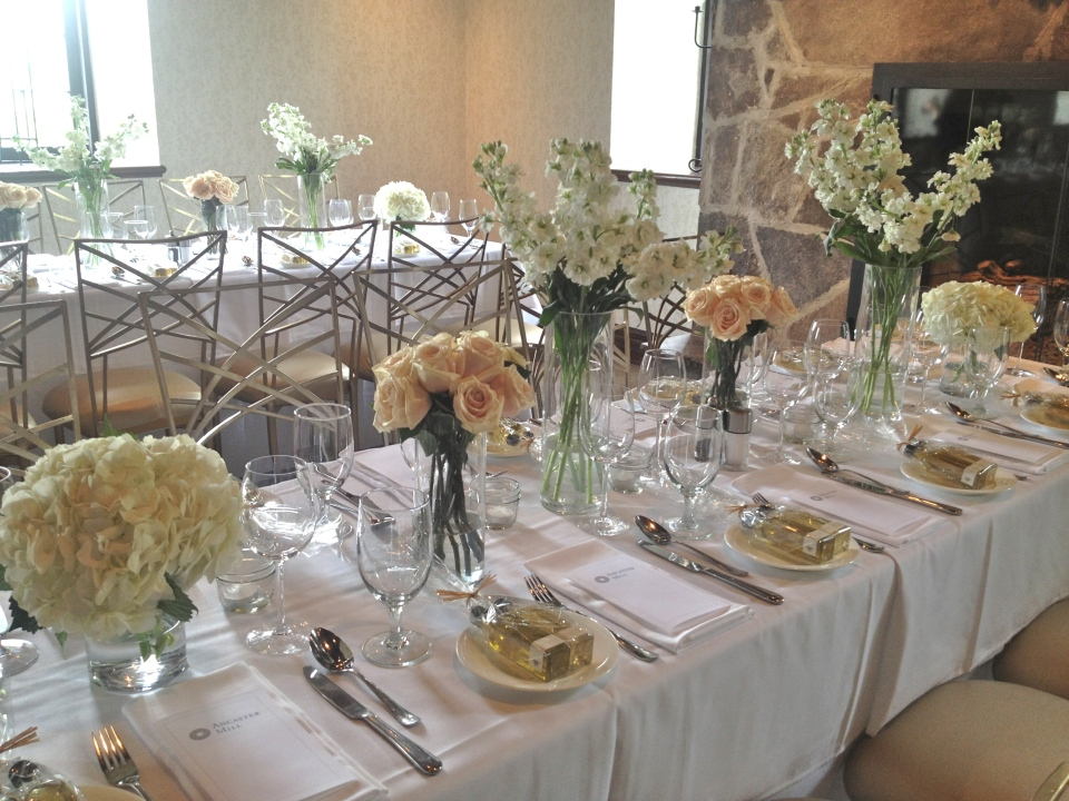 Arrangements of white stock, ivory hydrangea and champagne roses were placed down the length of the gallery tables